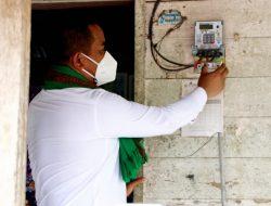 Bupati Pelalawan Resmikan Pemakaian Listrik 24 Jam di Desa Kuala Panduk